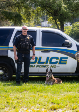 Police Vehicle With K9 and Officer