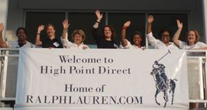 Ralph Lauren employees celebrate new facility.